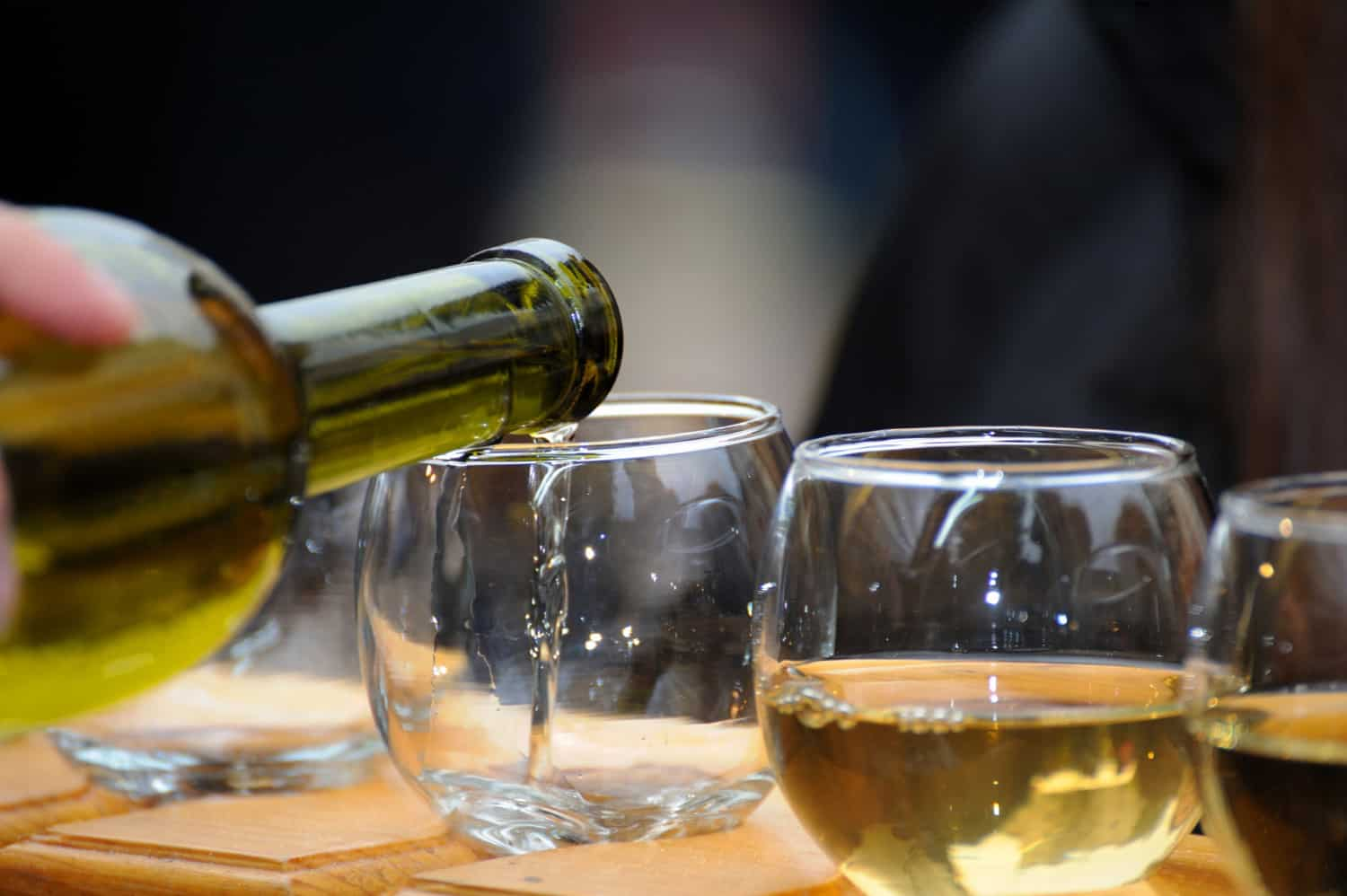 white-wine-poured-from-a-bottle-into-a-glass